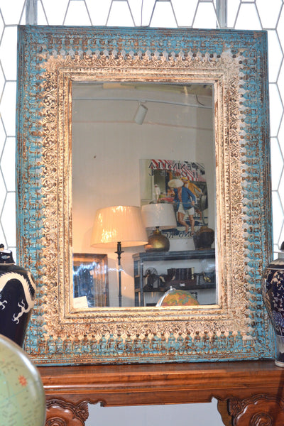 Blue and white framed mirror