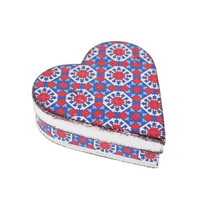heart shaped tin with blue and red geometric design
