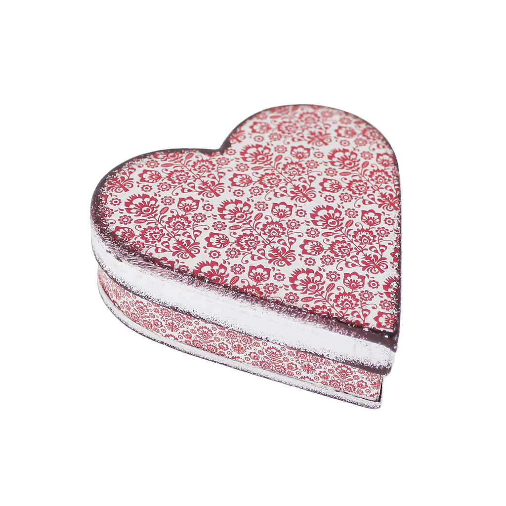 heart shaped tin with red and white design