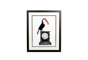 Framed and mounted print of toucan and vintage clock