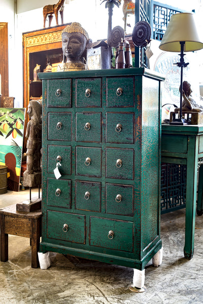 Green cabinet with drawers