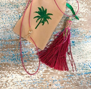 Pink tassel necklace on cord