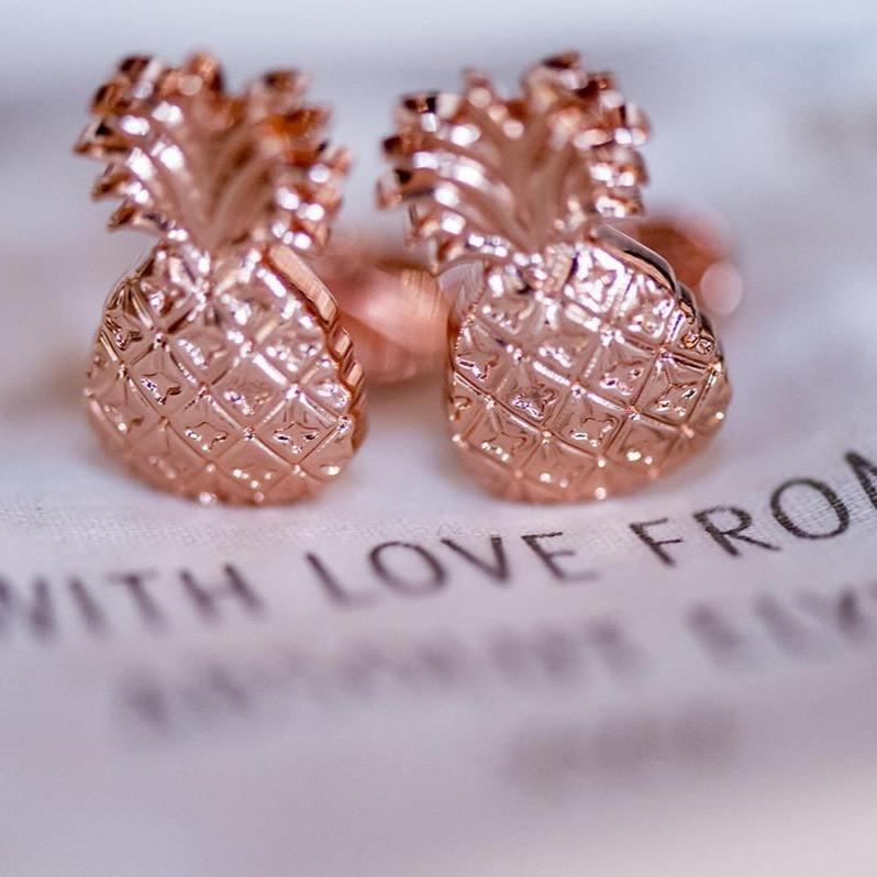 Absolut Elyx Copper Pineapple cufflinks close up