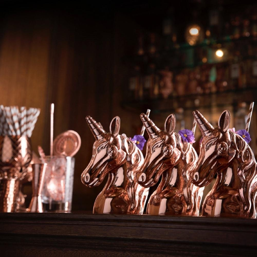 Trio of Copper Unicorns cocktail cups at the Mermaid Bar