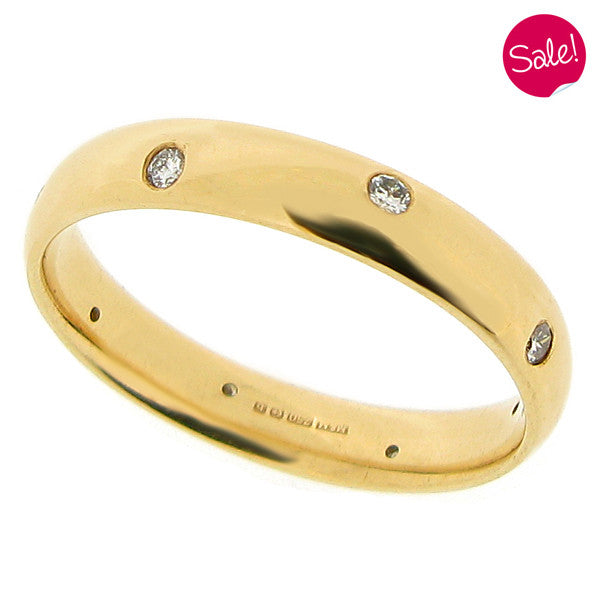 Diamond set band ring in 18ct yellow gold