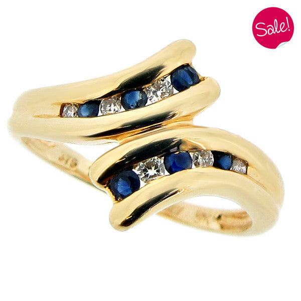 Sapphire and diamond twist ring in 9ct yellow gold