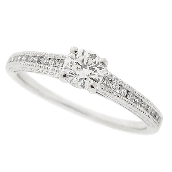 Diamond solitaire ring with diamond set shoulders in platinum, 0.49ct