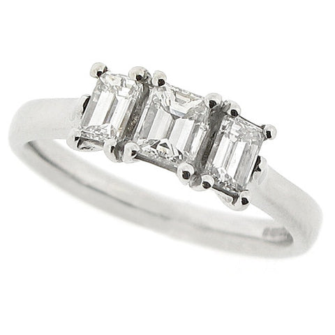 Emerald cut diamond three stone ring in platinum, 0.79ct