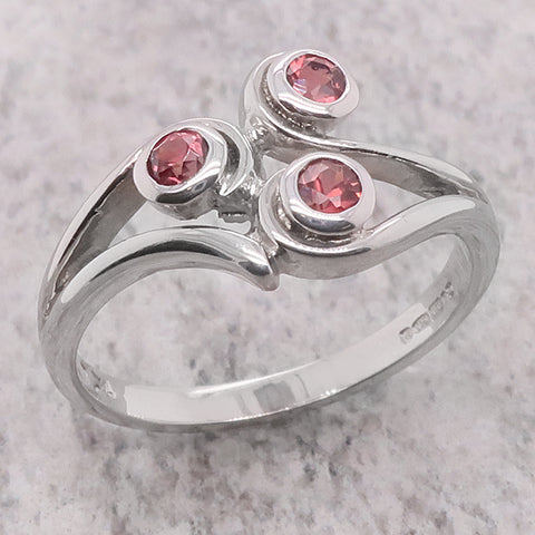 Garnet swirl dress ring in silver