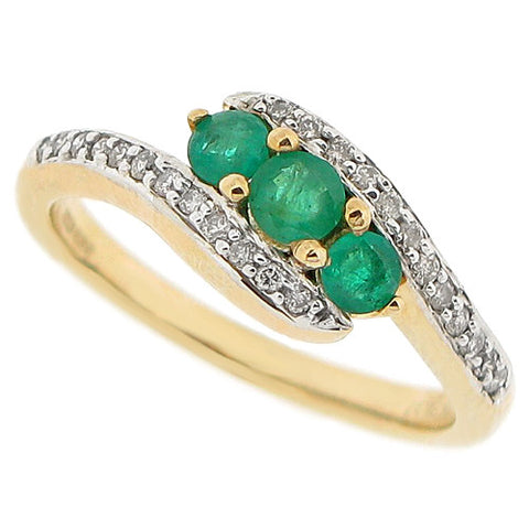 Emerald and diamond twist ring in 9ct yellow gold