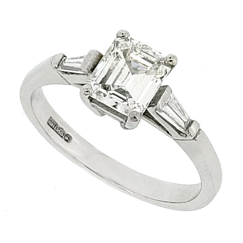 Emerald cut diamond three stone ring in platinum, 1.20ct