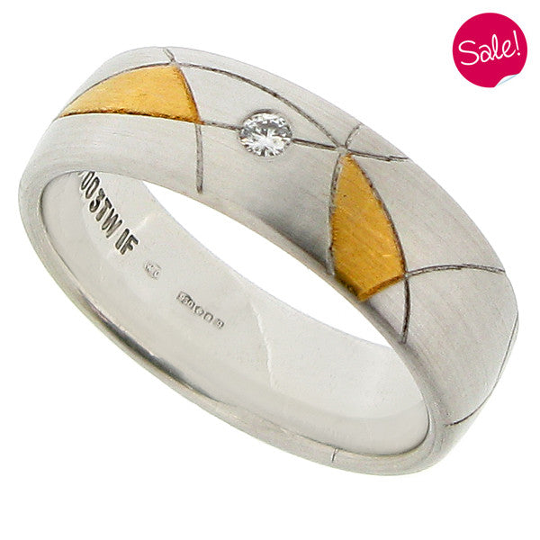 Diamond set abstract pattern band ring in platinum and 18ct yellow gold