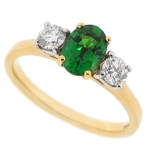 Tsavorite garnet and diamond three stone ring in 18ct gold