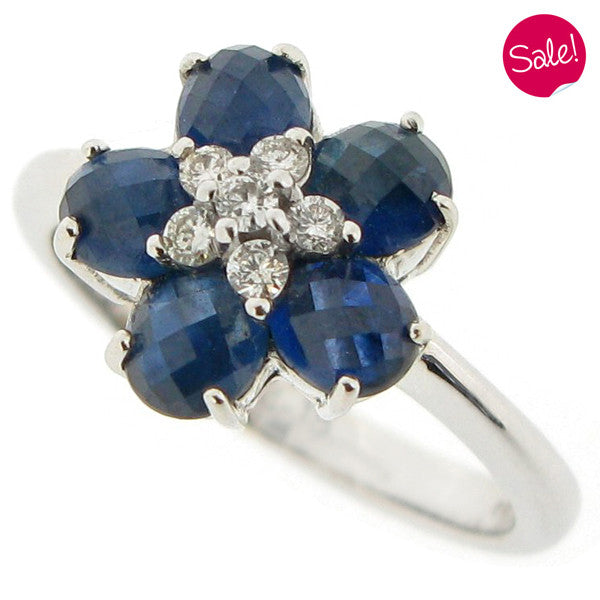 Sapphire and diamond floral cluster ring in 18ct white gold.