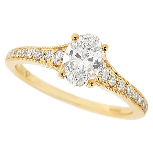 Oval diamond ring with diamond set shoulders in 18ct gold, 0.85ct