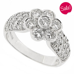Diamond floral cluster ring with diamond set shoulders in 18ct white gold, 1.70ct