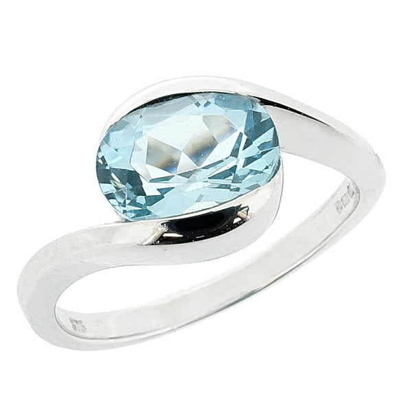 Blue Topaz twist solitaire ring in 9ct white gold