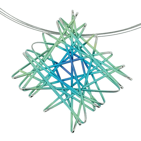 Green and blue chaos pendant and wire in titanium