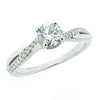 Brillianr cut diamond solitaire with diamond shoulders in platinum, 0.61ct