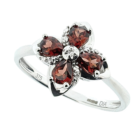 Garnet and diamond floral dress ring in 9ct white gold