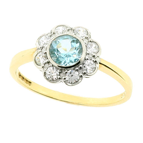 Blue topaz and cubic zirconia floral cluster ring in 9ct gold