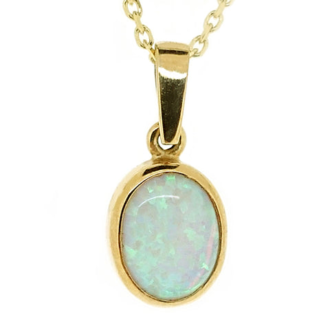 Simulated opal oval pendant and chain in 9ct gold