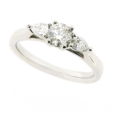 Brilliant and pear shape diamond three stone ring in platinum, 0.53ct
