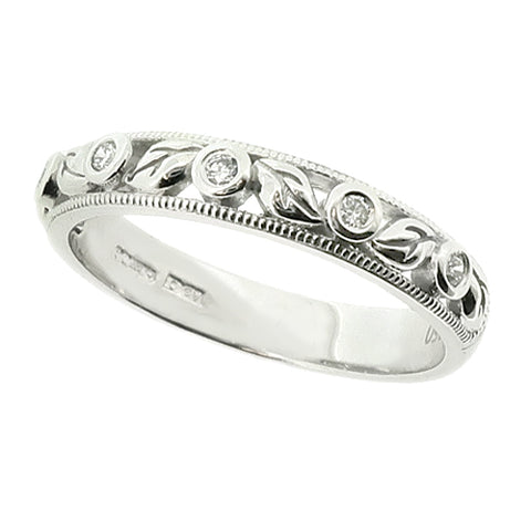 Leaf detail diamond set band ring in platinum, 0.07ct