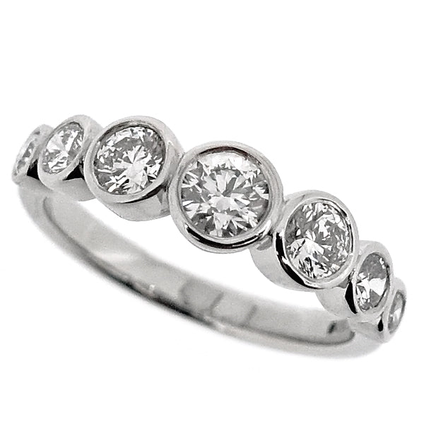 Rubover set diamond seven stone ring in platinum, 0.99ct