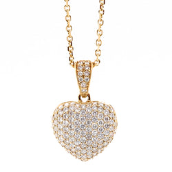 Diamond heart pendant and chain in 18ct gold, 0.91ct