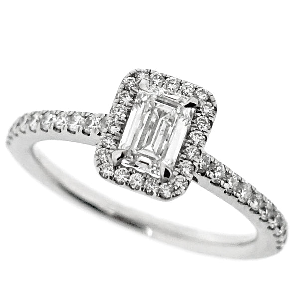 Emerald cut diamond halo cluster ring in platinum, 0.80ct