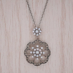 Freshwater pearl and marcasite flower pendant and chain in silver