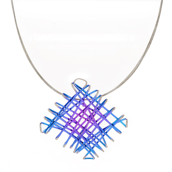 Pink and blue chaos pendant and wire in titanium and steel