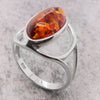 Amber dress ring in silver