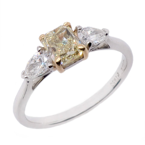 Fancy yellow and white diamond three stone ring in platinum and 18ct gold, 1.21ct