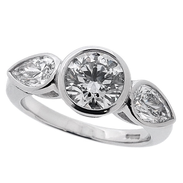 Diamond round brilliant and pear shape three stone ring in platinum, 1.68ct