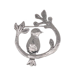 Bird on a branch brooch in silver