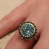 Blue topaz solitaire ring in silver with gold