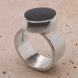 Black sea glass ring in silver