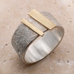 Abstract shapes broad ring in silver with gold
