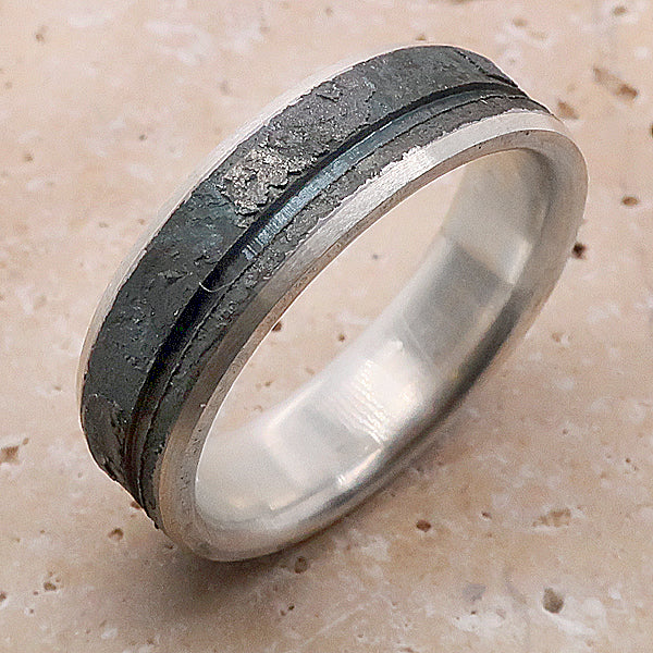 Grooved and textured ring in silver and steel
