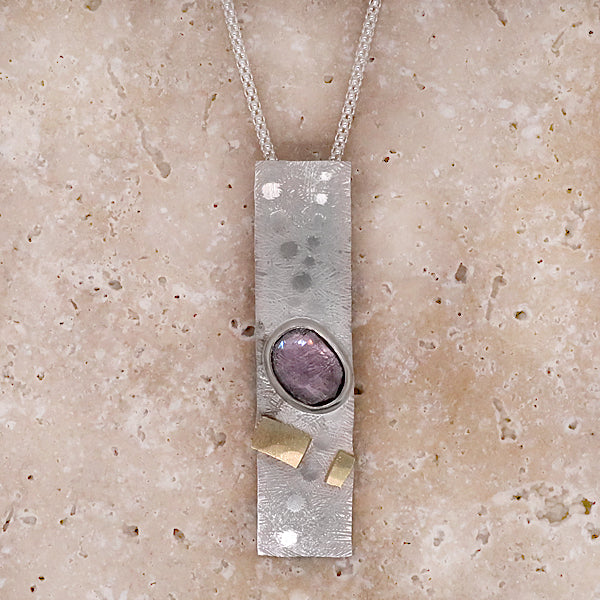 Purple tourmaline pendant and chain in silver with gold