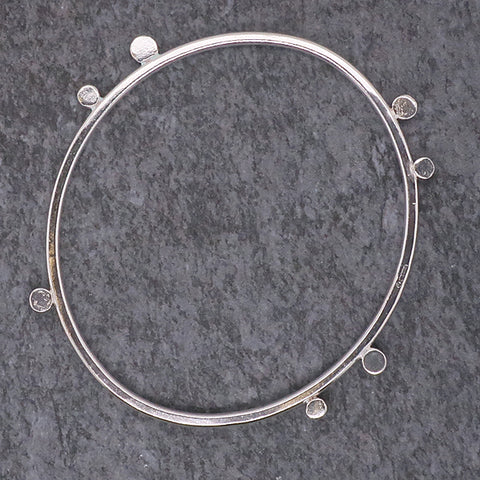 Disc detail bangle in silver