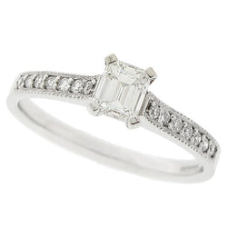 Emerald cut diamond ring with diamond set shoulders in platinum, 0.50ct