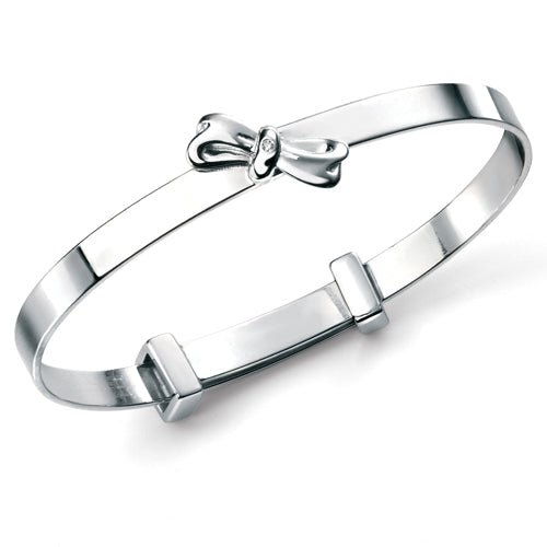 Bow detail diamond set expanding child's bangle in silver