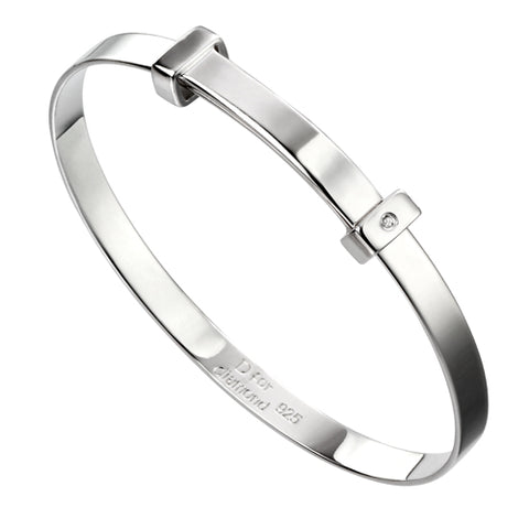 Diamond set child's expanding bangle in silver