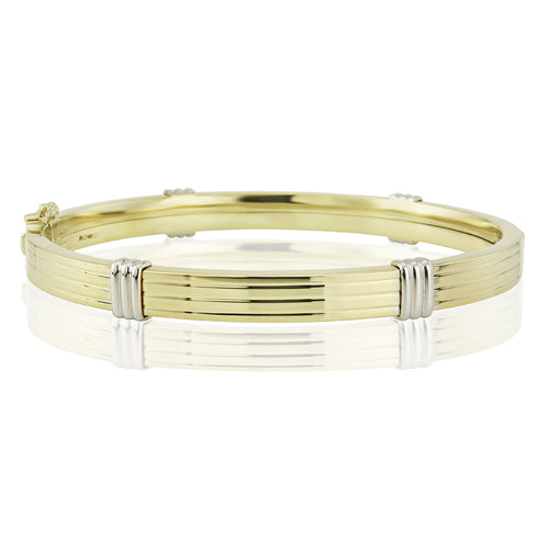 Groove detail hinged bangle in 9ct yellow and white gold