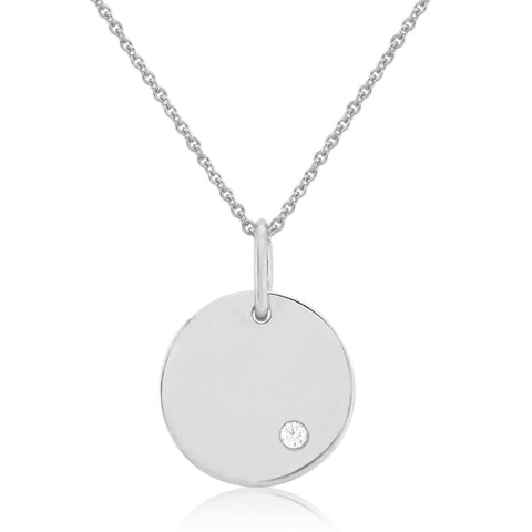 Diamond set disc pendant and chain in 9ct white gold