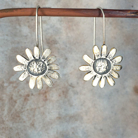 Embossed daisy drop earrings in silver