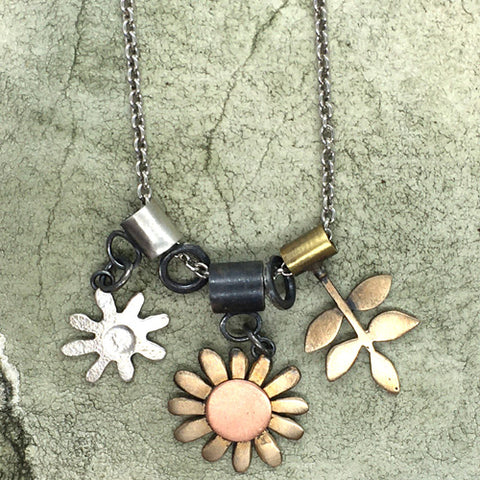 Daisy charm necklace in silver, copper and bronze